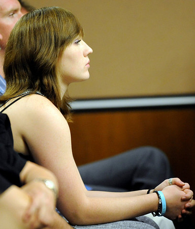 Jennifer Schmidt, mother of Jack Koller, listens to Benjamin Koller speak to the court during his sentencing hearing at the Boulder County Justice Center in Boulder, Colorado July 21, 2010.  Benjamin Koller pleaded guilty to child abuse resulting in death. CAMERA/Mark Leffingwell