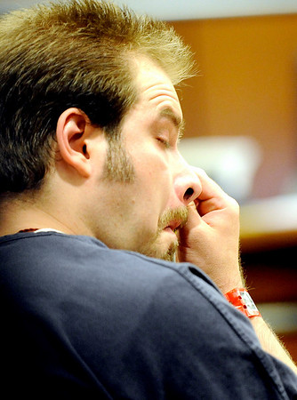 Benjamin Koller wipes his eyes after a power point slide show of photos of Jack Koller was shown during his sentencing hearing at the Boulder County Justice Center in Boulder, Colorado July 21, 2010.  Benjamin Koller pleaded guilty to child abuse resulting in death. CAMERA/Mark Leffingwell