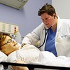 BEN GARVER — THE BERKSHIRE EAGLE<br /> Kelsey Lane, a nursing student at Berkshire Community College checks respiration during a simulation scenario in the nursing lab.  Wednesday November 5, 2018. The nursing simulation lab at BCC is a mock up of a hospital area with a computer controlled patient.
