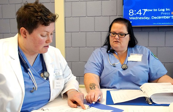 BEN GARVER — THE BERKSHIRE EAGLE<br /> Kelsey Lane (left) and April Curtin, nursing students at Berkshire Community College, review a patient chart before a simulation scenario in the nursing lab.  Wednesday, November 5, 2018.