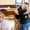 BEN GARVER — THE BERKSHIRE EAGLE<br /> Tamara Harvey and Ella Deane hug at a meeting of  the Berkshire Country Grandparents Raising Grandchildren at the First United Methodist Church in Pittsfield, Monday July 25, 2017. Michelle DiPalazzo is in the foreground.