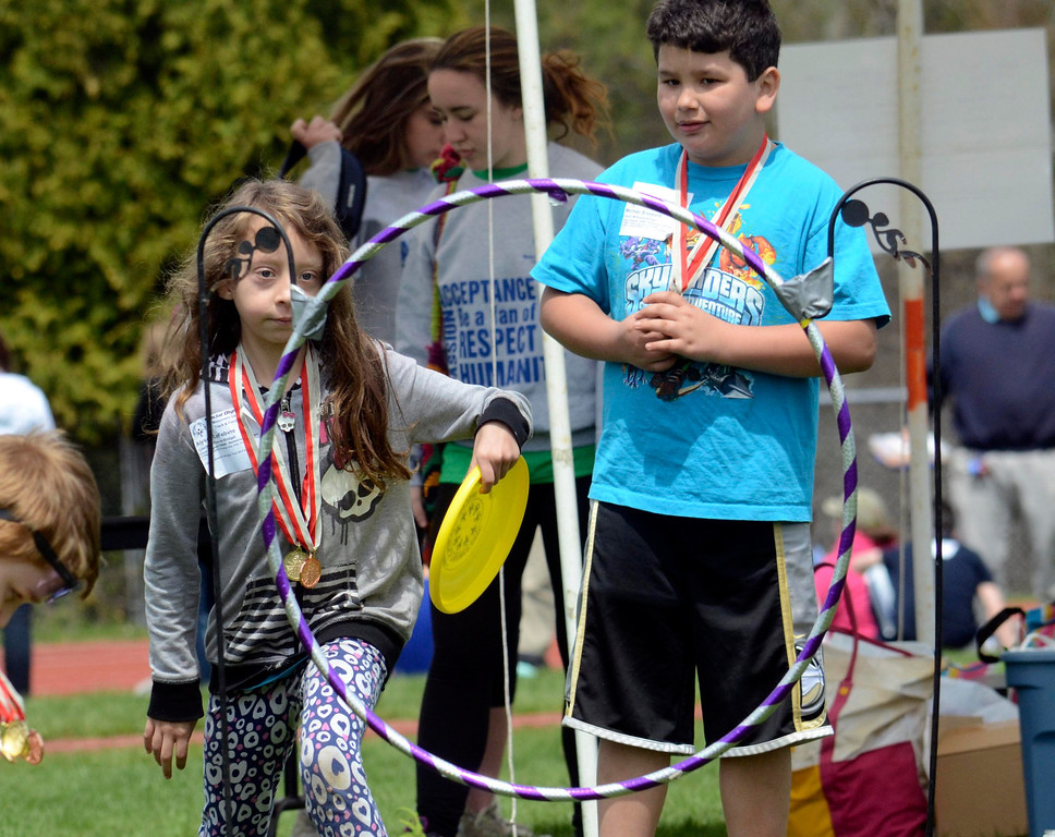 . Alyssa LeFebvre, 7, tosses a frisbee through a ring at the Berkshire County Special Olympics held in Great Barrington, Wednesday May 7, 2014.  Ben Garver / Berkshire Eagle Staff / photos.berkshireeagle.com