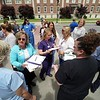 BEN GARVER — THE BERKSHIRE EAGLE<br /> Becky Armstrong (center) talks to employees of Berkshire Health Systems as they gather at the Bishop-Clapp Building to sign a petition for the RNs to accept a contract offer and gather for a group photo.  The employees are from all departments of the health system and fear a disruption of services caused by a strike. Over 110 people from the Pittsfield campus showed up for the brief demonstration.