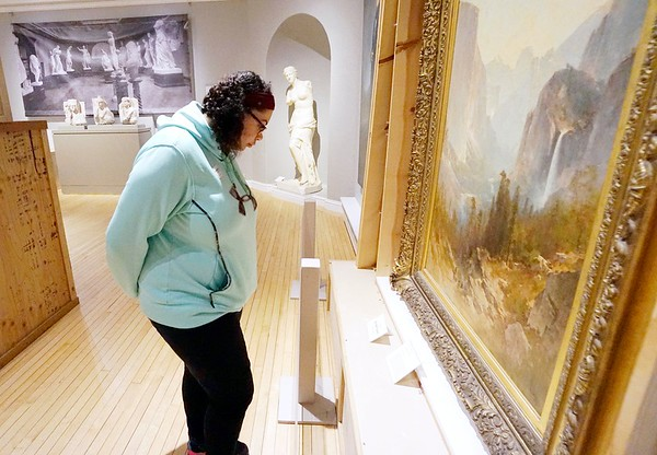 "BEN GARVER — THE BERKSHIRE EAGLE<br /> Natalie Johnson, 16, examines ""Yosemite Valley"" by Thomas Hill at the Berkshire Museum Wondow on the World: A Look into the Permanent Collection in gallery 208."