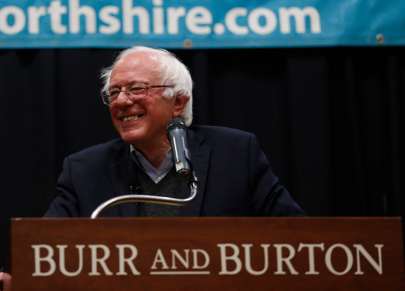 "U.S. Sen. Bernie Sanders smiles at the crowd on Tuesday afternoon as he talks about his book ""our Revolution, a future to believe in"" at the Riley Center at Burr and Burton Academy in Manchester.<br /> Holly Pelczynski - Bennington Banner"