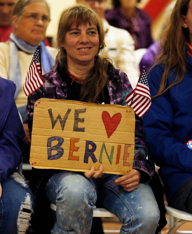 ". Holly Pelczynski - Bennington Banner Bonnie Eade, of Bennington, Welcomes Senator Bernie Sanders to the ount Anythony Union Middle School with a ""We Love Bernie\"" Sign."