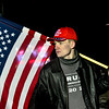 KRISTOPHER RADDER — BRATTLEBORO REFORMER<br /> Eli Larabee holds an American flag while showing his support of President Donald Trump during a protest outside of a rally for Democratic presidential candidate Sen. Bernie Sanders, I-Vt., at Stonewall Farm, in Keene, N.H., on Sunday, Dec. 22, 2019.