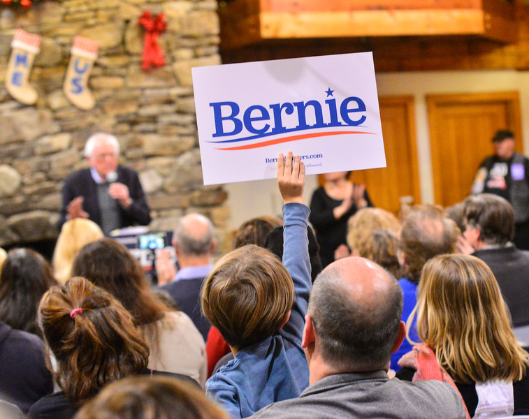 KRISTOPHER RADDER — BRATTLEBORO REFORMER<br /> Audie Klima, 7, from Chester, Vt., holds a during a rally at Stonewall Farm, in Keene, N.H., for  Democratic presidential candidate Sen. Bernie Sanders, I-Vt., on Sunday, Dec. 22, 2019