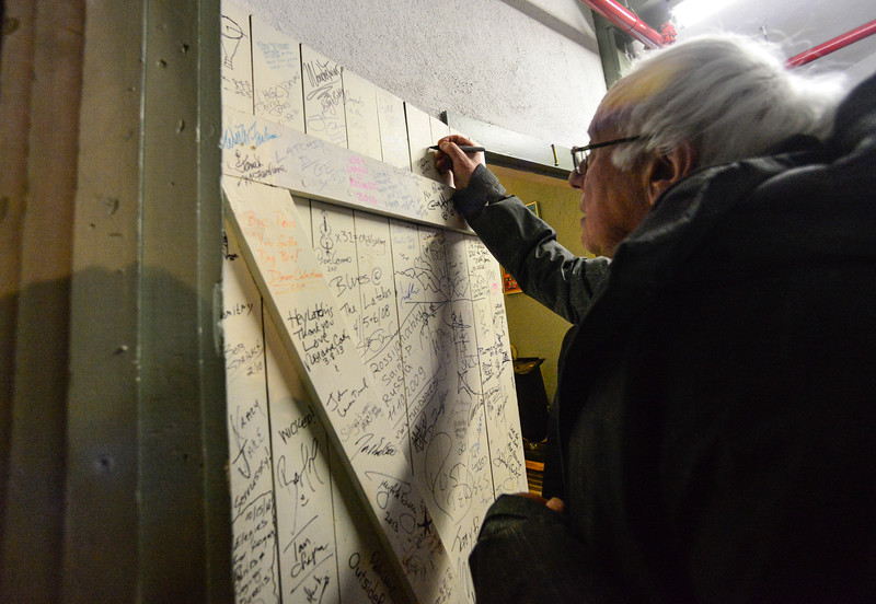 KRISTOPHER RADDER - BRATTLEBORO REFORMER<br /> U.S. Senator Bernie Sanders signs the door at the Latchis Theatre, in Brattleboro, Vt., after delivering a speech for Windham Grows on Thursday, March 16, 2017.