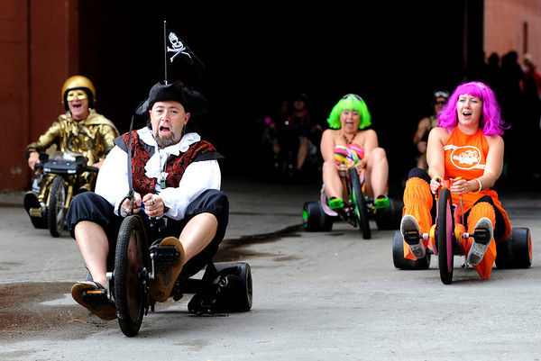 """Chris Vinall, center, leads the pack of Big Wheels in his pirate costume on Saturday, July 9, during the Big Wheel Rally in Boulder. For more photos and video go to  <a href=""""http://www.dailycamera.com"""">http://www.dailycamera.com</a><br /> Jeremy Papasso/ Camera"""