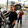 "Sherman Klaus, left, and Joe Yarid, both of Florida, carry their Big Wheels towards the meeting point on Saturday, July 9, during the Big Wheel Rally in Boulder. For more photos and video go to  <a href=""http://www.dailycamera.com"">http://www.dailycamera.com</a><br /> Jeremy Papasso/ Camera"
