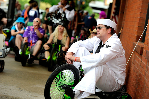 "Bryan Zimmerman, right, sits on his Big Wheel in a sailor uniform while waiting for the start whistle on Saturday, July 9, during the Big Wheel Rally in Boulder. For more photos and video go to  <a href=""http://www.dailycamera.com"">http://www.dailycamera.com</a><br /> Jeremy Papasso/ Camera"