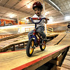 Davis Painter, 4, rides over a see-saw on the course during the mountain bike clinic at Boulder Indoor Cycling in Boulder, Colorado December 15, 2009.  CAMERA/Mark Leffingwell