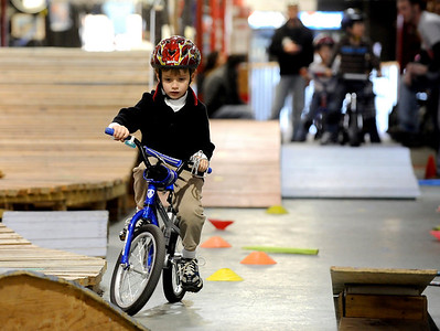 Walker Carlson, 5, negotiates the obstacle course during the mountain bike clinic at Boulder Indoor Cycling in Boulder, Colorado December 15, 2009.  CAMERA/Mark Leffingwell