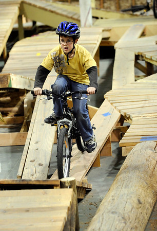 James Daly, 7, works his way through the course during the mountain bike clinic at Boulder Indoor Cycling in Boulder, Colorado December 15, 2009.  CAMERA/Mark Leffingwell
