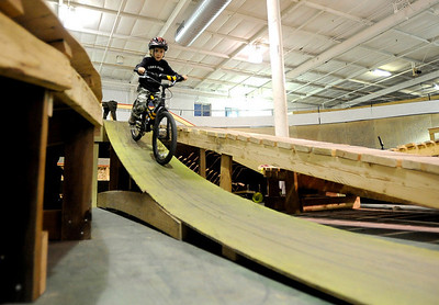 Max Glynn, 7, zooms down a ramp on the course during the mountain bike clinic at Boulder Indoor Cycling in Boulder, Colorado December 15, 2009.  CAMERA/Mark Leffingwell