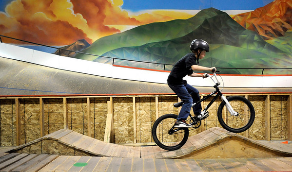 James Keller, 8, goes through the ramps on the course during the mountain bike clinic at Boulder Indoor Cycling in Boulder, Colorado December 15, 2009.  CAMERA/Mark Leffingwell