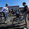 BIKE.JPG BIKE<br /> Ryan and Molly Broshar share a cup of coffee before heading out to work and school from the Ideal Market breakfast station on Bike to Work day.<br /> <br /> PHOTO BY MARTY CAIVANO<br /> June 22, 2011
