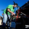 BIKE<br /> Joel Hernke, with Rocky Mounts, cleans a bike at the wash station held at the Ideal Market breakfast station on Bike to Work Day.<br /> <br /> Photo by Marty Caivano/June 22, 2011