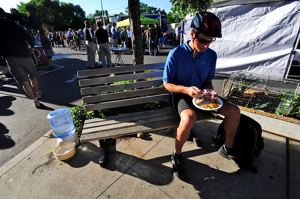 BIKE<br /> Dean Garyet takes a break on his way to work at IBM at the Ideal Market breakfast station on Bike to Work Day.<br /> <br /> Photo by Marty Caivano/June 22, 2011