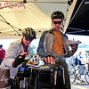 BIKE<br /> Patricia Summers, left, and her son Reed get coffee at the Ideal Market breakfast station on Bike to Work Day.<br /> <br /> Photo by Marty Caivano/June 22, 2011