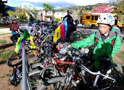 Third grader Noah Harding, right, parks his bicycle in the bike rack after riding to school during bike-to-school day on Thursday, April 19, at Foothills Elementary School in Boulder. For more photos and video of bike-to-school day go to www.dailycamera.com Jeremy Papasso/ Camera