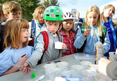 Pre-schooler Elizabeth Hoerter, left, and third-grader Evan Teague, center, wait for their serving of ice-cream after riding their bicycles to school during bike-to-school day on Thursday, April 19, at Foothills Elementary School in Boulder.For more photos and video of bike-to-school day go to www.dailycamera.com Jeremy Papasso/ Camera