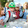 "Pre-schooler Elizabeth Hoerter, left, and third-grader Evan Teague, center, wait for their serving of ice-cream after riding their bicycles to school during bike-to-school day on Thursday, April 19, at Foothills Elementary School in Boulder.For more photos and video of bike-to-school day go to  <a href=""http://www.dailycamera.com"">http://www.dailycamera.com</a><br /> Jeremy Papasso/ Camera"