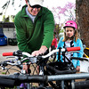 "Doug Rutherford helps his daughter Petra put her bicycle in the bike rack during bike-to-school day on Thursday, April 19, at Foothills Elementary School in Boulder.For more photos and video of bike-to-school day go to  <a href=""http://www.dailycamera.com"">http://www.dailycamera.com</a><br /> Jeremy Papasso/ Camera"