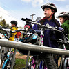 "Third-graders Abbie Gillach, center, and Olivia Dawson, right, park their bicycles in the bike rack during bike-to-school day on Thursday, April 19, at Foothills Elementary School in Boulder. For more photos and video of bike-to-school day go to  <a href=""http://www.dailycamera.com"">http://www.dailycamera.com</a><br /> Jeremy Papasso/ Camera"