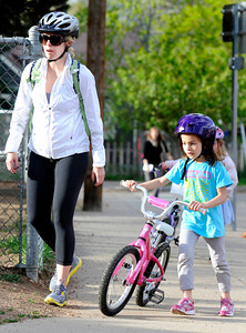 Elizabeth Rao walks her first-grade daughter Ivah Rao towards the bike rack after riding to school during bike-to-school day on Thursday, April 19, at Foothills Elementary School in Boulder.For more photos and video of bike-to-school day go to www.dailycamera.com Jeremy Papasso/ Camera