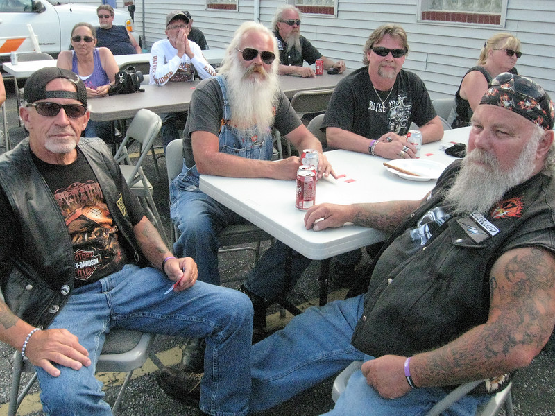 BOB SANDRICK / GAZETTE Shown clockwise from left are Jake Gillis of Columbia Station; Bob Foster of Wadsworth; Randy Crites of Spencer; Kim Diezman of Medina, and Rell Carver of Medina as they relax after Saturday's 120-mile poker run event that ended in Lodi.
