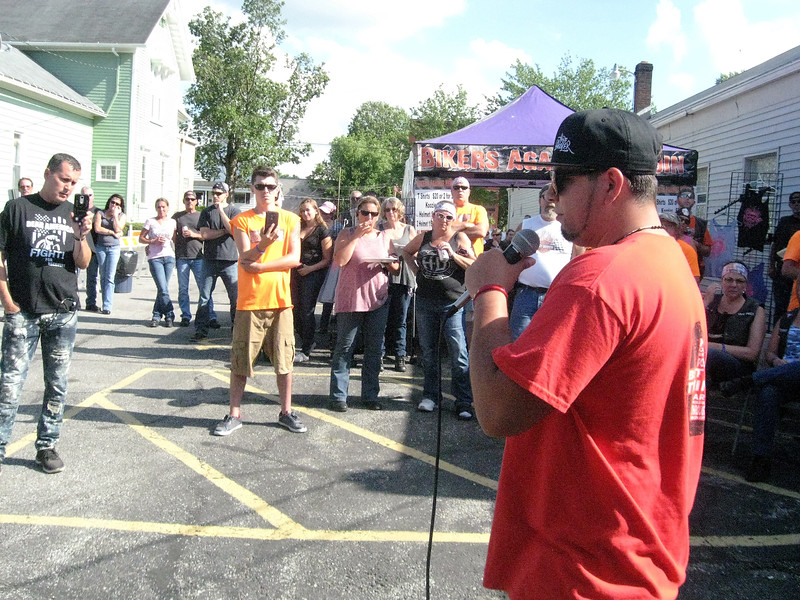 BOB SANDRICK / GAZETTE Cody Delgado, a recovering heroin addict from Clyde, offers a message of hope after a 120-mile motorcycle poker run held Saturday in Lodi.