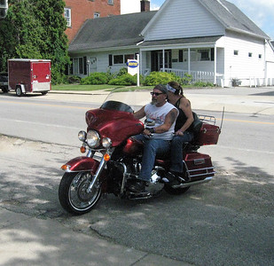 BOB SANDRICK / GAZETTE Denny and Venessa Mauder of Grafton ride into American Legion Post 523 in Lodi at the end of Saturday's poker run fundraiser.