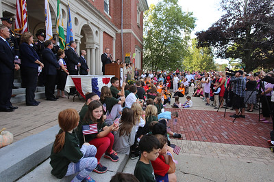 Gov. Charlie Baker signs a bill declaring that Billerica is Yankee Doodle Town, during a ceremony at the Billerica Public Library.  (SUN/Julia Malakie)