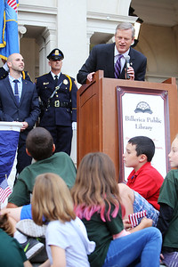 Gov. Charlie Baker signs a bill declaring that Billerica is Yankee Doodle Town, during a ceremony at the Billerica Public Library. Gov. Baker addresses the kids in front of him, saying that a policy issue he was speaking about wouldn't be of much interest to them. (SUN/Julia Malakie)