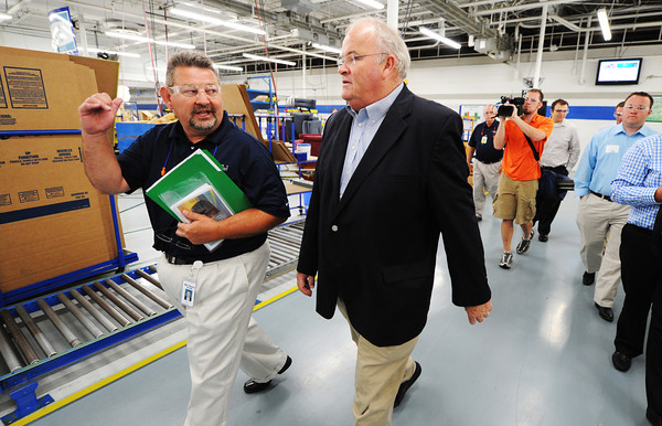 Globe/T. Rob Brown<br /> Neosho La-Z-Boy Vice President Bill Snow walks with Congressman Billy Long Wednesday morning, May 29, 2013, as they tour the Neosho facility. Long was leading a tour of Southwest Missouri manufacturers with the Missouri Association of Manufacturers.