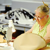 Globe/T. Rob Brown<br /> Pamela Young, sewing machine operator with MSW Restaurant Furnishings in Carterville, works on a barstool cover for Taco Bell Wednesday morning, May 29, 2013. MSW supplies more than a dozen restaurant chains with furninshings, including Taco Bell, KFC, TGI Fridays, Moe's and many others. Congressman Billy Long was leading a tour of Southwest Missouri manufacturers with the Missouri Association of Manufacturers.