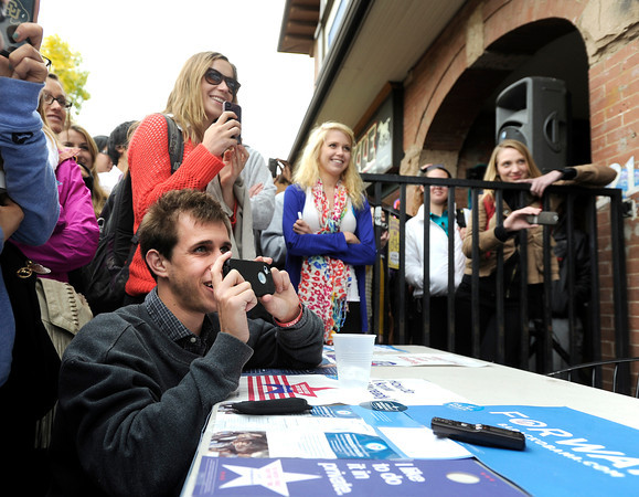 "University of Colorado junior Joe Wirth, left, records video of Black Eyed Peas star Will.i.am during an Obama campaign rally on Thursday, Oct. 4, outside of Half Fast Subs in Boulder. For more photos and video of Will.i.am in Boulder go to  <a href=""http://www.dailycamera.com"">http://www.dailycamera.com</a><br /> Jeremy Papasso/ Camera"