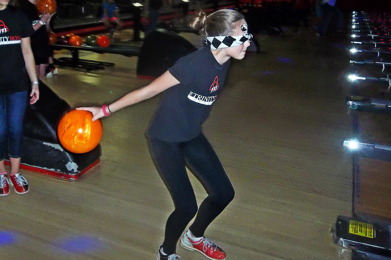 NIKKI RHOADES / GAZETTE Trinity Bonitz, 11, bowls blindfolded on Saturday during a fundraiser event at AMF Medina Lanes with the guidance of her partner Maddy Todorovich, 11. The fundraiser was to help families with children with eyesight conditions.