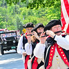 KRISTOPHER RADDER — BRATTLEBORO REFORMER<br /> Flutist plays as they march during the 10th annual Blueberry Festival Parade in Dover, Vt., on Saturday, July 27, 2019.