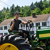 KRISTOPHER RADDER — BRATTLEBORO REFORMER<br /> Cooper Adams rides on a John Deere tractor during the 10th annual Blueberry Festival Parade in Dover, Vt., on Saturday, July 27, 2019.