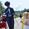 KRISTOPHER RADDER — BRATTLEBORO REFORMER<br /> Nick Roth, dressed as Mr. Blueberry, hands out lollipops to children during the 10th annual Blueberry Festival Parade in Dover, Vt., on Saturday, July 27, 2019.