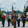 KRISTOPHER RADDER — BRATTLEBORO REFORMER<br /> People take photos of Civil War reenactor as they fire their muskets during the 10th annual Blueberry Festival Parade in Dover, Vt., on Saturday, July 27, 2019.