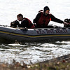 Boulder Police, Boulder Fire/Rescue and members of the Boulder Emergency Squad, look for evidence at the Boulder Reservoir after a man was found dead by members of the CU rowing team early Wednesday morning.<br /> Cliff Grassmick / April 7, 2010