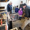 BEN GARVER — THE BERKSHIRE EAGLE <br /> Rick Wilbur stokes the fire on the boiler at Holiday Brook Farm in Dalton as Dicken Crane explains how maple syrup is made, Saturday, March 18. 2017.