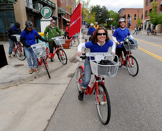 """Lisa Dumont leads a B-cycle group on a ride to NCAR during the opening day of the program.<br /> Boulder B-cycle is a community nonprofit formed to implement and operate a bike-share system in the City of Boulder. <br /> For more photos and a video of B-cycles opening day, go to  <a href=""""http://www.dailycamera.com"""">http://www.dailycamera.com</a>.<br /> Cliff Grassmick/ May 20, 2011"""