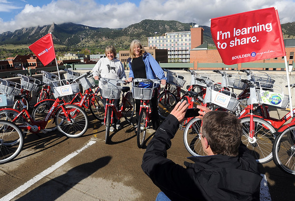"""Boulder Mayor, Susan Osborne, left, and council member, Crystal Gray, pose for a photo in front of the flatirons.<br /> Boulder B-cycle is a community nonprofit formed to implement and operate a bike-share system in the City of Boulder. <br /> For more photos and a video of B-cycles opening day, go to  <a href=""""http://www.dailycamera.com"""">http://www.dailycamera.com</a>.<br /> Cliff Grassmick/ May 20, 2011"""