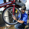"Hayden Stone, B-cycle maintenance director, checks out a bike before the launch on Friday.<br /> Boulder B-cycle is a community nonprofit formed to implement and operate a bike-share system in the City of Boulder. <br /> For more photos and a video of B-cycles opening day, go to  <a href=""http://www.dailycamera.com"">http://www.dailycamera.com</a>.<br /> Cliff Grassmick/ May 20, 2011"