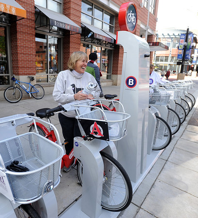"""Boulder Mayor, Susan Osborne, puts away her B-cycle after an opening ride.<br /> Boulder B-cycle is a community nonprofit formed to implement and operate a bike-share system in the City of Boulder. <br /> For more photos and a video of B-cycles opening day, go to  <a href=""""http://www.dailycamera.com"""">http://www.dailycamera.com</a>.<br /> Cliff Grassmick/ May 20, 2011"""